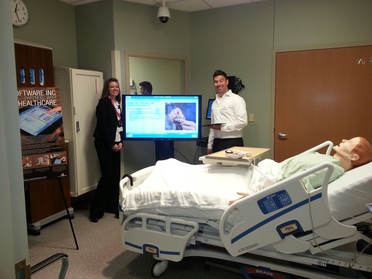 Nick Striegel, Multimedia Developer at CSE Software Inc. and nurse scholar Cassandra Kurtz demonstrate the new Smart Pump app developed by CSE.